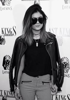 Kylie Jenner, oversized shades, leather jacket, striped pants. Xo, LisaPriceInc.