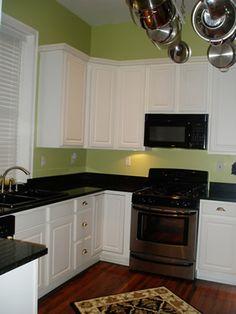 uba tuba granite with white cabinets | has Uba-Tuba granite countertops, tall white raised-panel cabinets ...