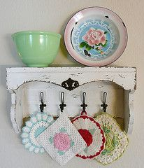 kitchen shelf with some of the old pot holders and dishes.  betty