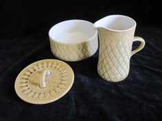 "Vintage mid century Danish modern Nissen Kronjyden Relief pattern, Sugar bowl with lid and cream jug. Designed by Jens H. Quistgaard. - $40     Please note, the lid to the sugar bowl appears to be a factory second as it has a glazed chip in the lower edge where it would fit into the bowl. The base of the bowl still bears it original black paper label "" Kronjyden Danmark "" and the creamer bears no marks. *See Photos."