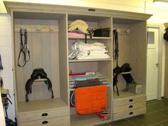 This could be really great in a smaller home barn: Refinish old entertainment center for tack organization.