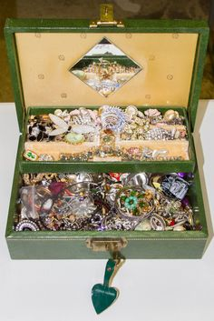 Lot 564: 10k White Gold and Costume Jewelry Assortment; 10k gold bracelet and costume pins, earrings, rings and necklaces; includes jewelry box