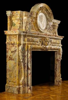 A Rare and Impressive Sarrancolin Opera Marble Chimneypiece in the Baroque manner.