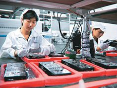 Fabricação do iPad na Foxconn da China.