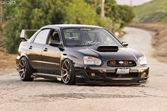 2005 Subaru WRX/STI - reminds me of the happier times. I assume that's why I let my husband buy his car back..