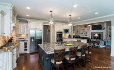 A massive central island is the highlight of this #kitchen. The Spotswood - Plan 1310. http://www.dongardner.com/house-plan/1310/the-spotswood. #KitchenIsland #FloorPlan