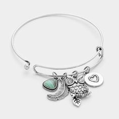 Now available on our store Owl & Feather Cha... Check us out here! http://lumidfashion.com/products/owl-feather-charm-hook-bracelet?utm_campaign=social_autopilot&utm_source=pin&utm_medium=pin