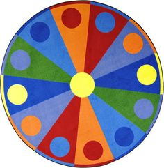 Roll Through The Dayu0027s Activities With This Vibrant Color Wheel™ Carpet At  The Center Of
