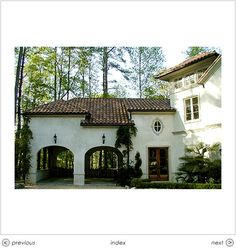 Double carport is interesting.  Not that practical, but interesting.    Carport Spanish Colonial style.