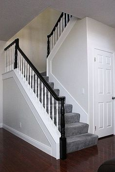 Lampert Daggett I think I am going to paint mine black, just railing a. Lampert Daggett I think I am going to paint mine black, just railing and banisters. here is a pic with carpeted stairs like yours. Black Stair Railing, Stair Banister, Black Stairs, White Staircase, Banisters, Wood Stairs, White Banister, Black Painted Stairs, Painted Banister
