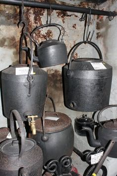 Old cooking pots and camp ovens, for use over open fire. Pahiatua Museum