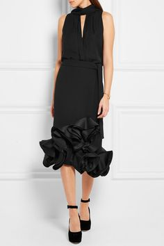 Black crepe and duchesse-satin Tie and zip fastening along side 100% polyester; lining: 100% silk Dry clean  Imported