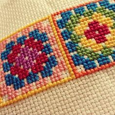 Close Up of Colorful Embroidered Squares
