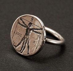 "Sterling silver seal ring with the famous ""Vitruvian Man"" of Leonardo da Vinci. An Italian one Euro coin is used for the image.            blindspotjewellery on Etsy"