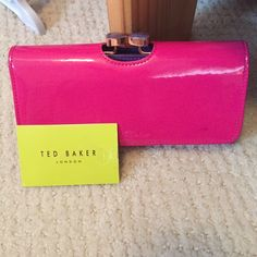 AUTHENTIC Ted Baker Wallet Used with wear throughout. One dark marking on the front, with wear on the inside leather portion. Some faint scratches on external portion. A tear on the tag. 11 card slots, 1 ID slot, one coin pouch area with 2 pockets inside.  One back zipper pocket. Ted Baker Bags Wallets