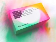 IS Creative Studio business cards customised with airbrush and neon colors.