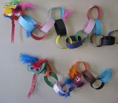 Chinese New Year Paper Chain Dragon Craft. Attach sticks to beg/mid/end to use as a puppet Chinese New Year Dragon, Chinese New Year Party, Chinese New Year Crafts, New Year's Crafts, Holiday Crafts, Crafts For Kids, Arts And Crafts, Preschool Projects, Activities For Kids