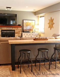 Love the idea of sofa table and seats. man or guy friendly family room decorating ideas with a bar table and stools behind the sectional to watch tv with sherwin williiams pewter tankard and live edge wood table behind sectional couch Bar Table And Stools, Pub Table Sets, Bar Tables, Bar Table Diy, Drink Table, Rustic Table, Family Room Decorating, Family Room Design, Decorating Ideas