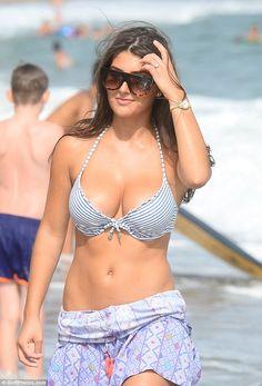 Striking: Sadie showed off her enviable figure in a stripy halterneck bikini