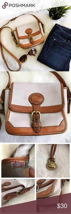 "Vintage Dooney & Bourke small tan crossbody bag PLEASE NOTE: this bag is in vintage condition Overall wear and marks and darkening of leather Hardware has wear but is all in functioning condition  One exterior slip pocket, one interior zipper pocket and 2 small slip pockets Strap drop 22 1/4"" at longest, adjustable. Width measured from the edge not from widest point when pressed flat Please Review all photos thoroughly  Feel free to ask questions.  🚫trades 🚫modeling requests 👍🏻Reasonable…"