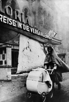 Woman with Gasmask (Berlin Kurfürstendamm 23.11.1943). Photographer's copyright stamp address 70000 Stuttgart and annotated in ink/pencil on the verso. Wolf Strache considered this iconic image taken during WWII his best work and it has become a symbol of that time. The original negative was confiscated shortly after its production and Strache made another negative in the 1970s with which he made later prints. - One retouched spot in upper left, some buckling, otherwise in good condition.