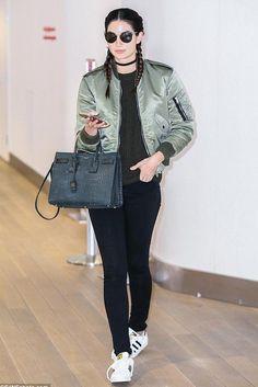 Lily Aldridge wearing Saint Laurent Sac De Jour Small Croc-Embossed Leather Tote Bag, Adidas Originals Sneakers and Saint Laurent Shell Bomber Jacket