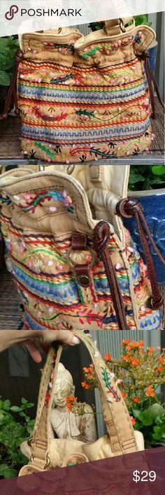 HP! Lucky Brand boho tribal embroidered tote Host Pick 1 /15 /2017! Adorable fabric tote bucket bag. Embroidery has a lot of texture with little knobs of fuzzy thread that stick out. Leather strap detail and handles are long enough to wear over shoulder. Inside is clean. There's also a fob attached. Bag holds a lot medium size at 12 by 12. There is no closure for this bag by design but I mention it in case it's a deal breaker.  Check out the other wonderful items I have for sale and bundle…