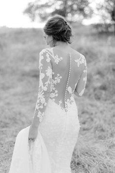 Back detail of lace wedding gown dress with see-through skin detail and button up back. Long sleeves and long trail with veil. #southafricanwedding #elopinginsouthafrica #capetownweddingphotographer #yolandemarx #winefarmweddingcapetownsouthafrica