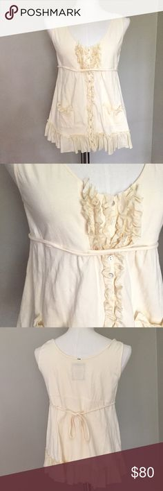 "Anthropologie Pinkerton boho ruffle button tank L Sweet top with romantic silk ruffles down the front, trim of the pockets, and hem. Tie back.  Perfect for summer BBQ S or step up accessories with skinnys for date night.  Cotton with a touch of stretch.  Gently preloved.   Approximate flat lay measurements: Length: 25 1/4"" Bust across pit to pit: 16.5"" A Anthropologie Tops Tank Tops"