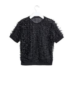 Keep a sharp silhouette and toss on one of these textured tops!