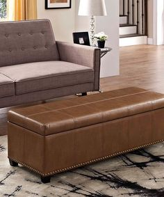 Take a look at this Tan Kingsley Leather Storage Ottoman today!