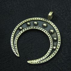 Lunula is the pagan symbol of moon and femininity. It is a kind of amulet worn by Slavic or Viking women in the pre-christian ages, that brings good luck