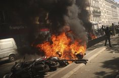 PARIS (AP) — French yellow vest protesters set fires Saturday along a march through Paris to drive home their message to a government they believe is ignoring the poor: that rebuilding the. Warm Spring, Spring Day, Ap French, French President, Paving Stones, Victor Hugo, Les Miserables, Paris Street, Kansas City