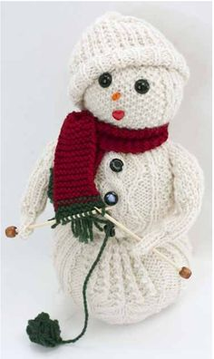 Free Knitting Pattern for Swow Knitter - Frost Flower is a stuffed snow person who is knitting a scarf. Approx. 10″ without hat. Designed by Susie Bonell for Cascade Yarns.