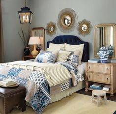 Just like a classic blue blazer, navy goes beautifully with gold accents. We chose an inky velvet headboard and gold mirrors to give this bedroom some serious drama.