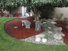 What about mixing river rock and pea gravel or red rock areas in the design?