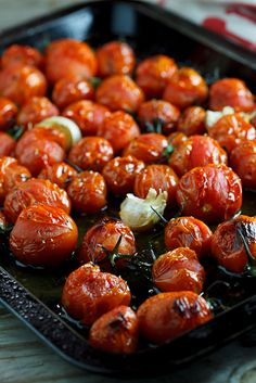 Roasted Tomatoes.   1.To make the roasted tomatoes, pre-heat the oven to 220°c and place the tomatoes in a roasting tray and add the garlic.   2.Drizzle with the olive oil and season with the salt & pepper.   3.Place in the oven for 25-30 minutes until the tomatoes are blistered and starting to burst open.   ( 220 c is about 420 f oven temp)
