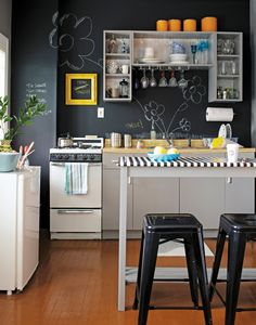 Kitchen or Studio? - Matte chalkboard paint on walls; - The First Apartment Book: Cool Designs for Small Spaces I NEED to do a wall with chalk board paint for my boys! First Apartment, Apartment Kitchen, Apartment Design, Kitchen Interior, Kitchen Decor, Kitchen Walls, Kitchen Ideas, Space Kitchen, Kitchen Layout