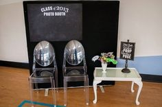 Hang a chalkboard backdrop for an easy classroom-themed photo booth.