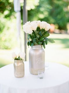 Spray-painted, glitter-dipped mason jars -- the perfect DIY project! | Something Borrowed