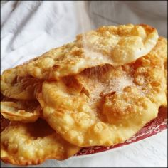 Coscorões, fried crispy-sweet rounds of dough, that are sprinkled with sugar and cinnamon are an Azorean dessert traditionally served at Car...