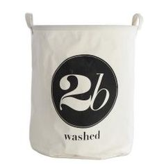 """Practical and stylishly modern fabric laundry bag from House Doctor, with a whimsical """"2b washed"""" printed motto.Made from a stiff cotton that folds down flat  when not in use. PE coated on the inside  providing water resistance.H 50cmDia 40cm"""
