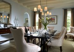 Create A Formal Dining Room With Elegant Furniture And Complementary Paint Colors