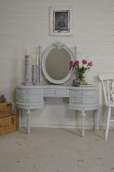 No room for a deep dressing table in your bedroom? We adore this slimline vintage beauty with it's ornate style and rustic charm! Painted in Farrow & Ball Lamp Room Grey with a dry-brush effect. #shabbychicfurniture #vintagefurniture https://www.thetreasuretrove.co.uk/bedroom-storage/vintage-shabby-chic-slimline-dressing-table