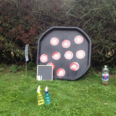 Take Aim! I would stick or write the numbers on a wall and then use a wet sponge to throw at the numbers.