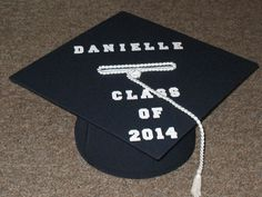 Put cards in a cool personalized graduation card box!