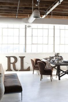 LOVE those chairs at that rustic table in the industrial loft ... the art of mixing!