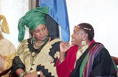 African Greats: Winnie Mandela (L), former wife of ANC leader Nelson Mandela, talks to the late singer Miriam Makeba at the announcement of a three-day concert and summit to aid African children. The photo was taken on November 6, 1991. Photo © Bettmann/CORBIS