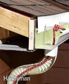The fix: Drop in a rope http://www.familyhandyman.com/roof/gutter-repair/9-easy-gutter-repairs