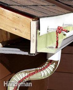 The fix: Drop in a rope http://www.familyhandyman.com/roof/gutter-repair/9-easy-gutter-repairs